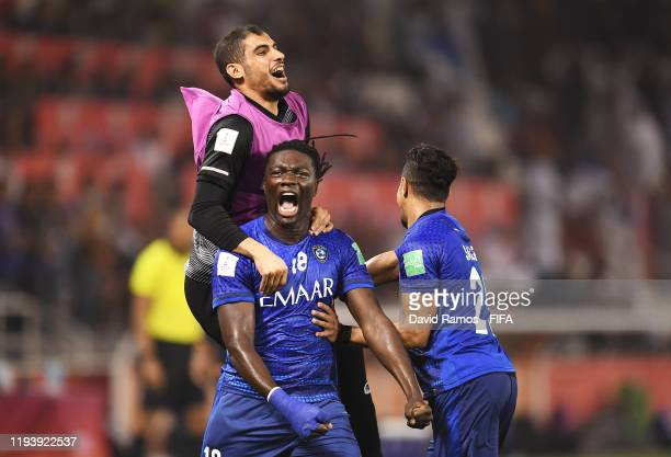 Bafetimbi Gomis of Al Hilal SFC celebrates with teammates after scoring his team's first goal during the FIFA Club World Cup 2nd round match between...