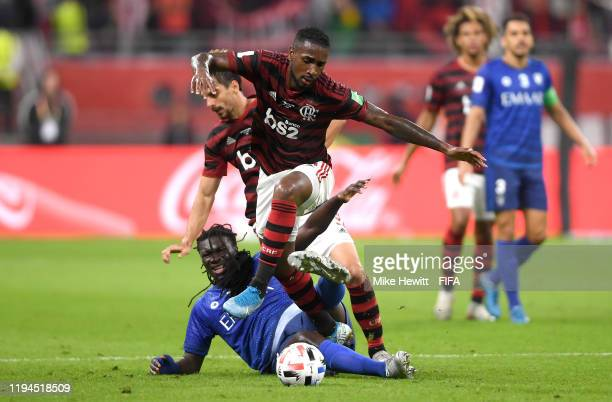 Bafetimbi Gomis of Al Hilal SFC tackles Gerson of CR Flamengo during the FIFA Club World Cup semifinal match between CR Flamengo and Al Hilal FC at...
