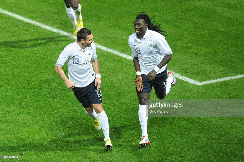 Bafetimbi Gomis (R) of France celebrates with Anthony Reveillere after scoring their second goal during the international friendly match between Italy and France at Stadio Ennio Tardini on November 14, 2012 in Parma, Italy.