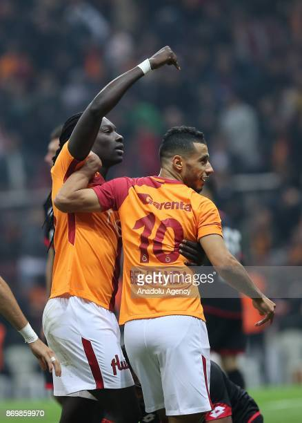 Bafetimbi Gomis of Galatasaray celebrates his score with Younes Belhanda during a Turkish Super Lig match between Galatasaray and Genclerbirligi at...