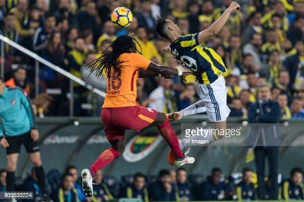 Bafetimbi Gomis of Galatasaray SK Josef de Souza Dias of Fenerbahce during the Turkish Spor Toto Super Lig match Fenerbahce AS and Galatasaray AS at...