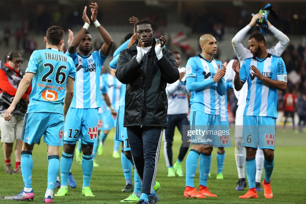 Bafetimbi Gomis of OM and teammates thank the supporter following the Ligue 1 match between Lille OSC (LOSC) and Olympique de Marseille (OM) at Stade Pierre-Mauroy on March 17, 2017 in Lille, France.