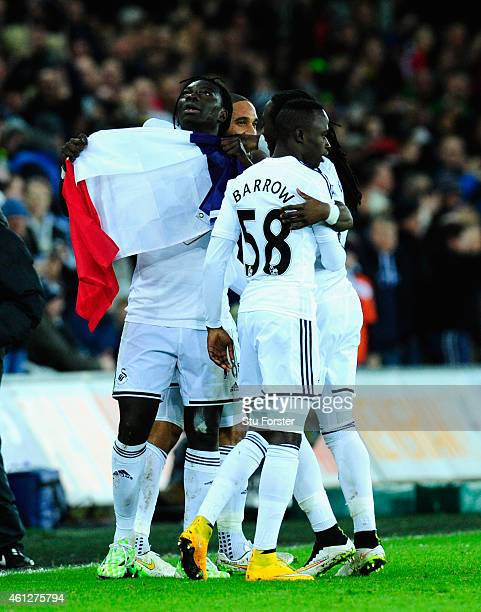 Bafetimbi Gomis of Swansea celebrates with team mates and the France national flag after scoring during the Barclays Premier League match between...