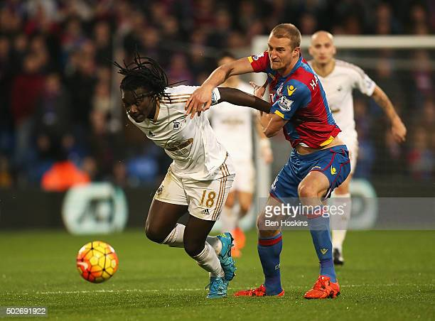 Bafetimbi Gomis of Swansea City and Brede Hangeland of Crystal Palace compete for the ball during the Barclays Premier League match between Crystal...