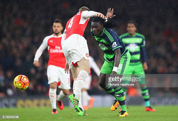 Bafetimbi Gomis of Swansea City battles for the ball with Per Mertesacker of Arsenal during the Barclays Premier League match between Arsenal and...