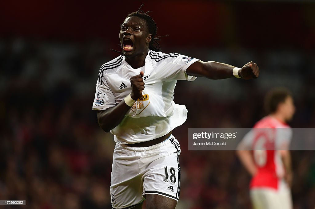 Bafetimbi Gomis of Swansea City celebrates scoring the opening goal during the Barclays Premier League match between Arsenal and Swansea City at Emirates Stadium on May 11, 2015 in London, England.
