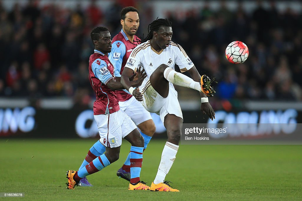 Bafetimbi Gomis of Swansea City controls the ball under pressure of Idrissa Gueye of Aston Villa during the Barclays Premier League match between Swansea City and Aston Villa at Liberty Stadium on March 19, 2016 in Swansea, United Kingdom.