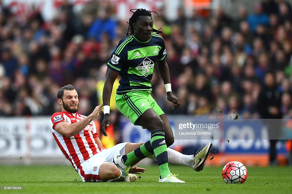 Bafetimbi Gomis of Swansea City is tackled by Erik Pieters of Stoke City during the Barclays Premier League match between Stoke City and Swansea City at Britannia Stadium on April 2, 2016 in Stoke on Trent, England.