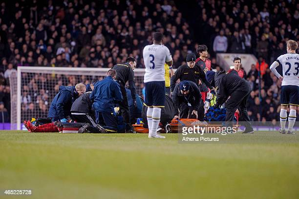 Bafetimbi Gomis of Swansea City is treated by club medical staff after collapsing during the Premier League match between Tottenham Hotspur and...