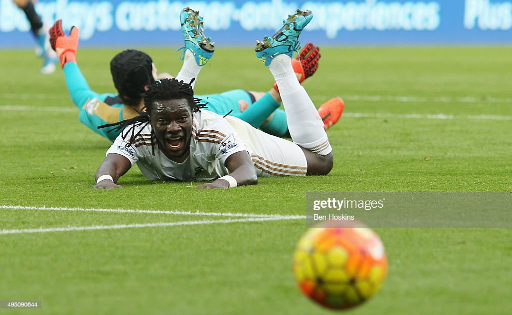Bafetimbi Gomis of Swansea City reacts after brought down by Petr Cech of Arsenal during the Barclays Premier League match between Swansea City and Arsenal at Liberty Stadium on October 31, 2015 in Swansea, Wales.