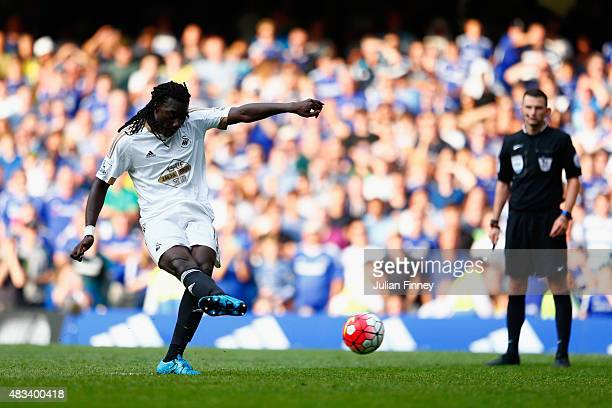 Bafetimbi Gomis of Swansea City scores his team's second goal from the penalty spot during the Barclays Premier League match between Chelsea and...