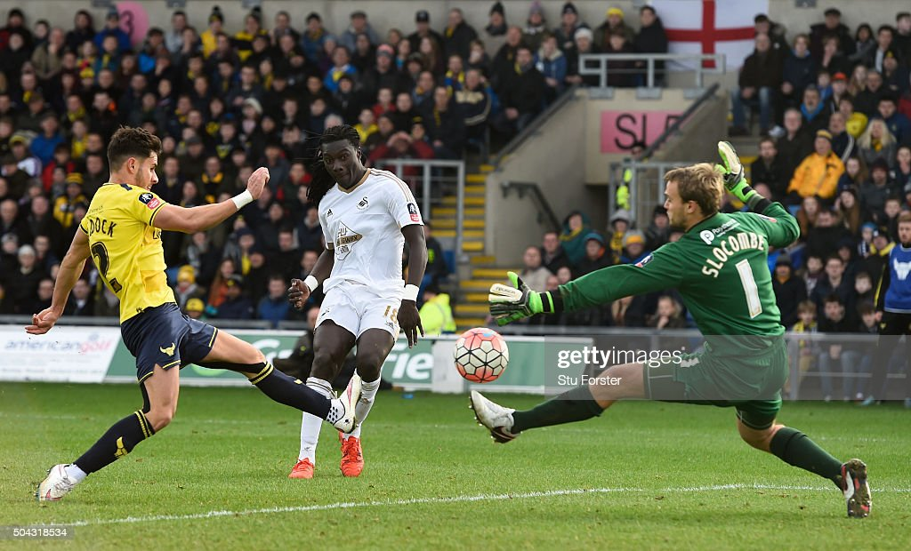 Bafetimbi Gomis of Swansea City shoots past goalkeeper Sam Slocombe of Oxford United to score his team's second goal during The Emirates FA Cup third round match between Oxford United and Swansea City at the Kassam Stadium on January 10, 2016 in Oxford, England.