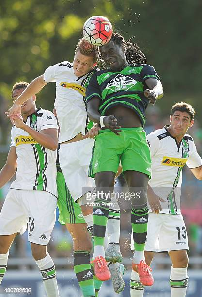 Bafetimbi Gomis of Swansea is challenged by Nico Elvedi of Borussia Moenchengladbach during the City Preseason Friendly between Borussia...