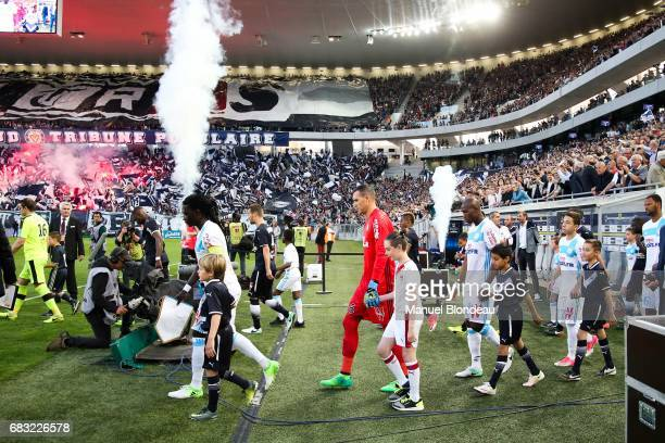 Bafetimbi Gomis Yohann Pele and Rod Fanni of Marseille walk on the pitch during the Ligue 1 match between Girondins de Bordeaux and Olympique de...