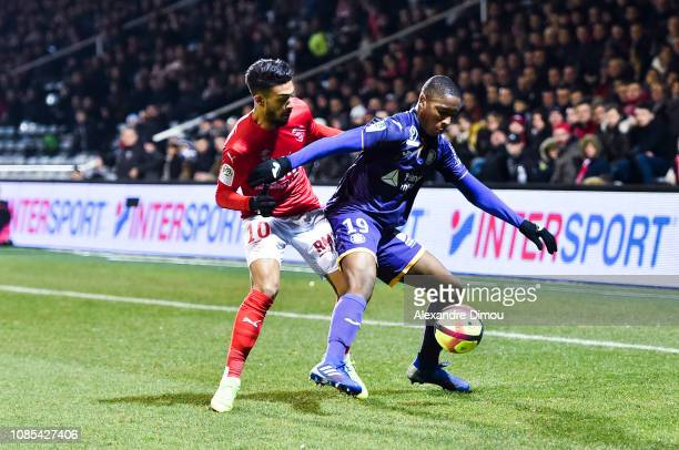 Bafode Diakite of Toulouse and Denis Bouanga of Nimes during the Ligue 1 match between Nimes and Toulouse at Stade des Costieres on January 19 2019...
