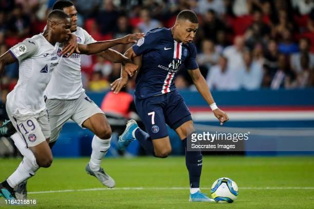Bafode Diakite of Toulouse Kelvin Amian of Toulouse Kylian Mbappe of Paris Saint Germain during the French League 1 match between Paris Saint Germain...