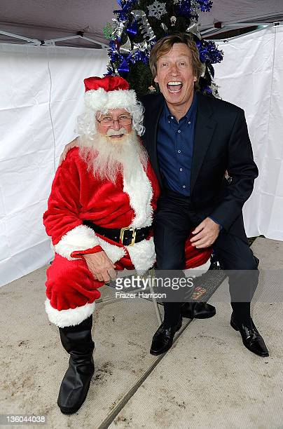 BAFTAs Gary Dartnall poses with Chairman of BAFTA Los Angeles producer Nigel Lythgoe at BAFTA LA's 6th Annual Christmas Party and Toy Drive at Helen...