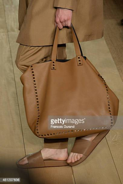 Bag and shoe details are senn as a model walks the runway during the Valentino show as part of the Paris Fashion Week Menswear Spring/Summer 2015 on...