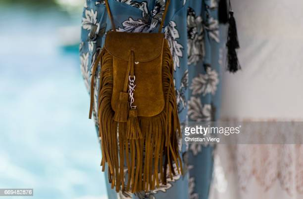 YSL bag at the Revovle Festival during day 3 of the 2017 Coachella Valley Music Arts Festival Weekend 1 on April 16 2017 in Indio California