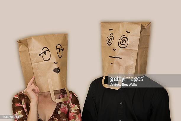 bag headed woman flirting, bag headed man swooning