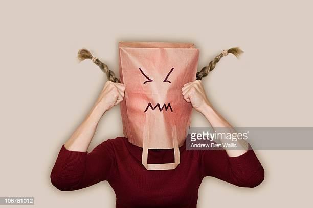 bag headed woman looking angry