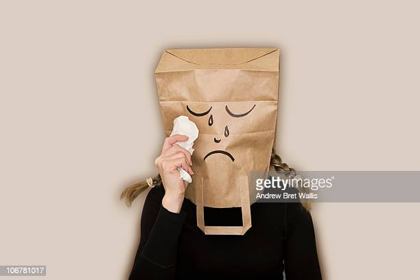 bag headed woman sad and crying - handkerchief stock photos and pictures