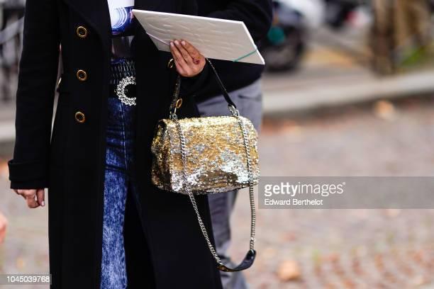 A bag is seen outside Miu Miu during Paris Fashion Week Womenswear Spring/Summer 2019 on October 2 2018 in Paris France
