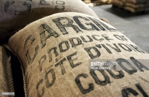 A bag of cocoa marked 'Cargill' for the American cocoa firm waits at a warehouse at the port in Abidjan Ivory Coast May 4 2004 The facility is...