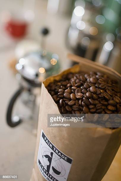 Bag of coffee beans with coffee maker