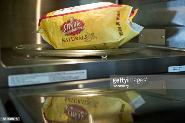 A bag of ConAgra Brands Inc Orville Redenbacher's Naturals brand microwave popcorn is arranged for a photograph in Tiskilwa Illinois US on Sunday...