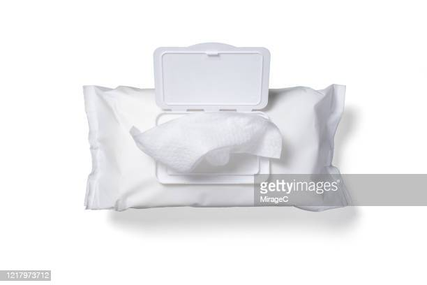 a bag of disposable disinfection wet wipe on white - wet wipe stock pictures, royalty-free photos & images