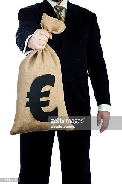 Bag of Euros in hand on white