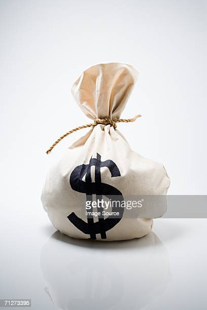 bag of money - money bag stock pictures, royalty-free photos & images