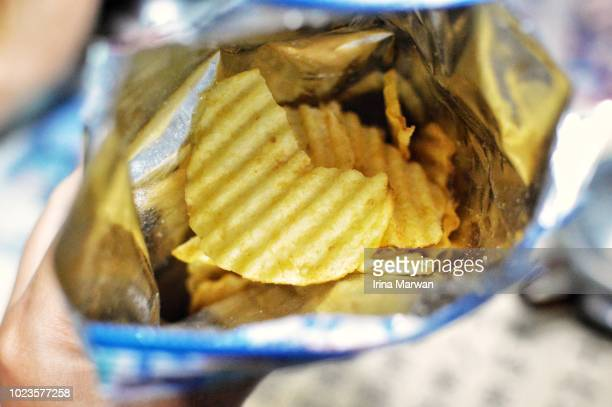bag of potato chips - savory food stock pictures, royalty-free photos & images