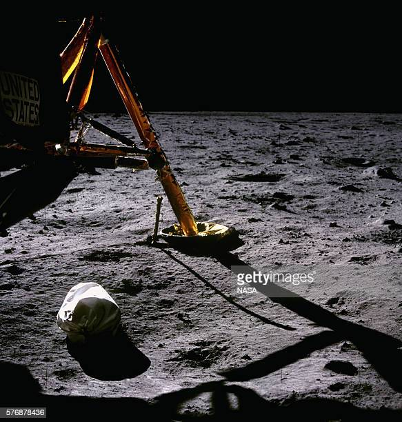 A bag of used equipment from Apollo 11 the first moon landing mission lies on the surface of the Moon next to the Eagle lunar module The astronauts...