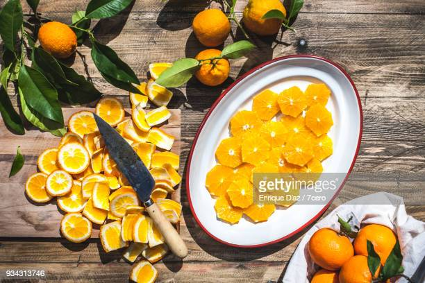 A bag of Valencia Oranges, sliced in the sunshine.