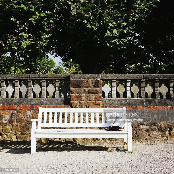 Bag On Wooden Bench Against Surrounding Wall