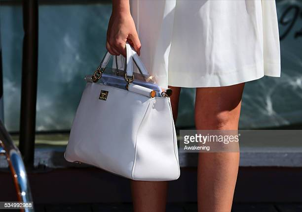 Bag particular of Cristiana Capotondi leaving from the Hotel Excelsior during the 71th Venice Film Festival in Venice Italy