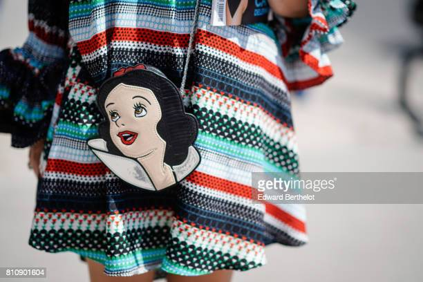 A bag showing the Disney character Snow White outside the Chanel show during Paris Fashion Week Haute Couture Fall/Winter 20172018 on July 4 2017 in...