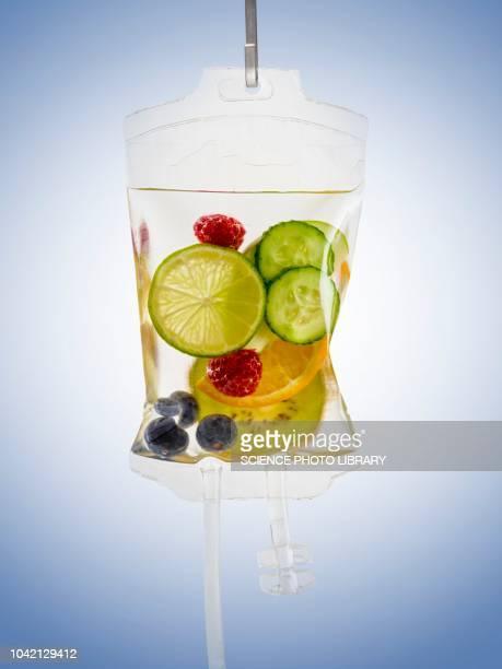 iv bag with fruits - dokterstas stockfoto's en -beelden