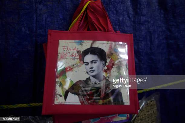 A bag with the image of Mexican artist Frida Kahlo is seen during the Frida Kahlo's 110th birthday anniversary at the Coyoacan's market on July 06...