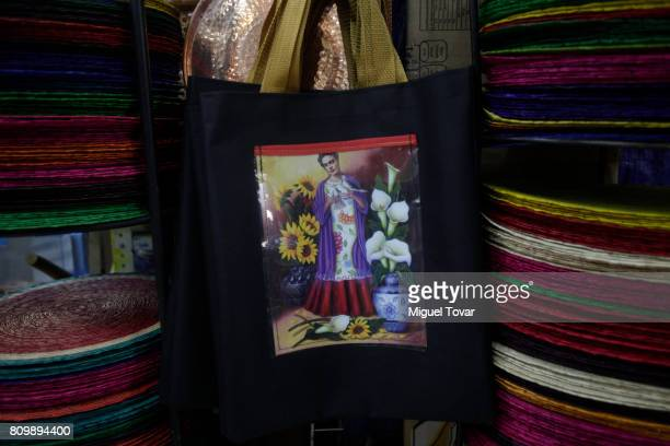 A bag with the image of the Mexican artist Frida Kahlo is seen during the Frida Kahlo's 110th birthday anniversary at the Coyoacan's market on July...