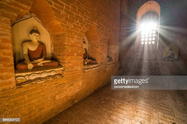 Bagan ancient temple indoors in archeological zone at sunrise, Myanmar