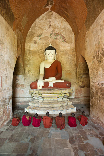 Bagan, Buddhist monks sitting in Temple