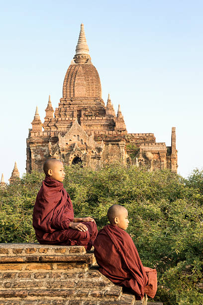 Bagan, Buddhist monks sitting on temple top