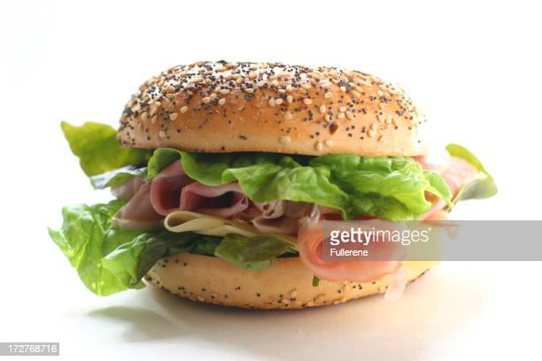 Bagel sandwich with assorted ingredients on white background