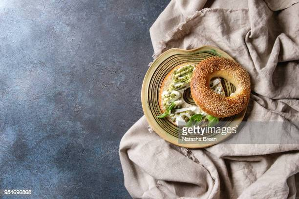 bagel with cream cheese - pesto stock pictures, royalty-free photos & images