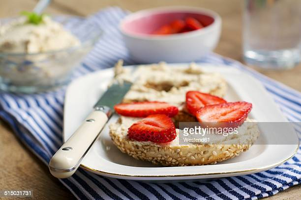 Bagel with fresh strawberries on home made vegan cream cheese