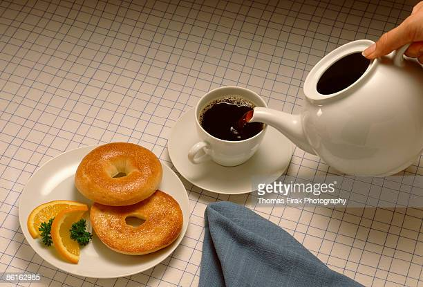bagels and tea -  firak stock pictures, royalty-free photos & images