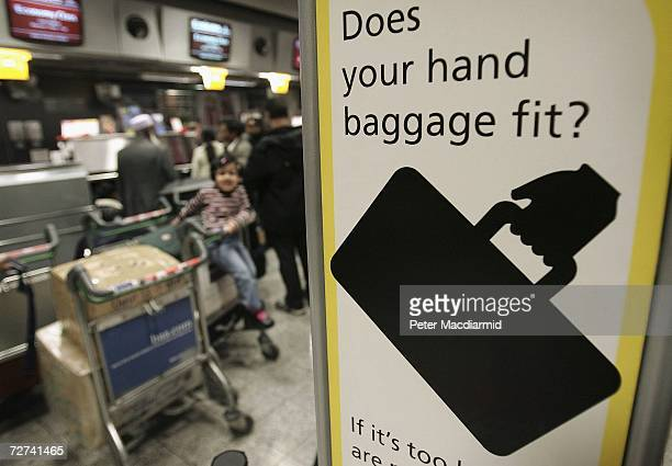 A baggage allowance sign is displayed at checkin at terminal three on December 6 2006 at London's Heathrow airport England Passengers are being...